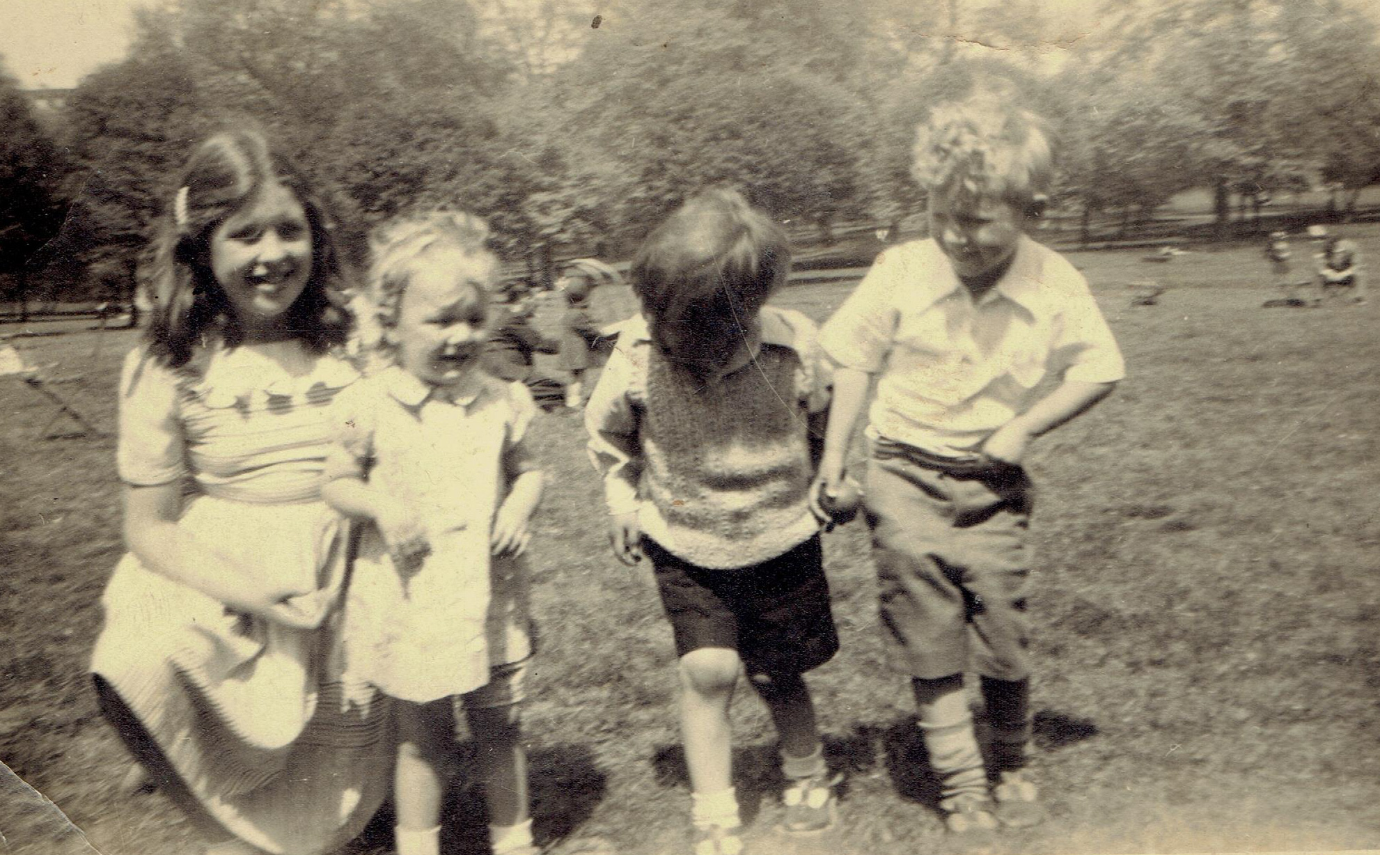 4 children face the camera but James Adcock looks away, again.