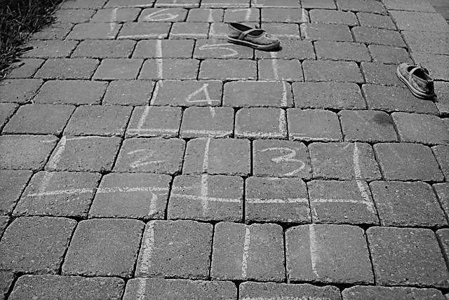 A chalk drawing on bricks of the childhood game, Hopscotch.