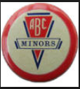 A circular badge in colours of red, white & blue. Text and logo reading, ABC Minors