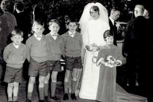 Unintended consequences occur in marriage. This image shows a young bride photographed on her wedding day with her nephews.