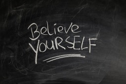 "Chalk board with writing, ""Believe Yourself"" on it. Relating to writing Pen Portraits if you have a writers's block."